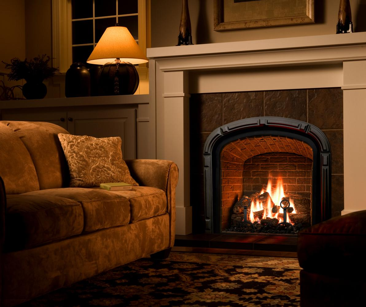 Custom Fireplace Surrounds. Custom metal frames for fireplaces Pictures of lit fireplaces