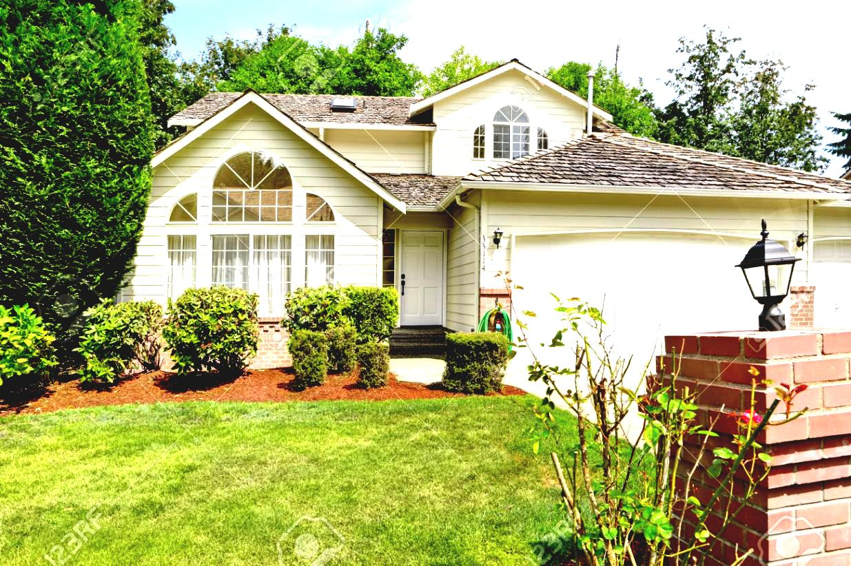 front-yard-landscape-with-landscaping-house-modern-exterior-garage-trimmed-bushes-and-green-lawn-stock-photo